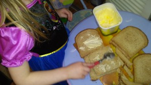 Just an ordinary butter knife or a even a spoon is all that is needed to learn to spread butter on bread.