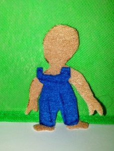 3.5 inch felt Ginger Nap doll in overalls.