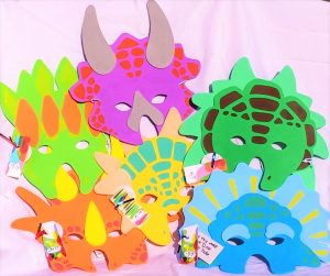 Foam dinosaur masks add to the DinosaurDig experince. See Heart Felt Play Store for collection of Dinosaur party favors kids love.