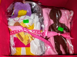 Felt doll sets craft by Malika Bourne the No Non-cents Nanna. Start at $2 to $3. with doll blanket and pillow . Standard sets will come witha random selection of clothes.