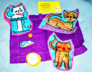 Felt cats set; 3 cats; mouse; bowl of milk; blanket. Cats were cut out of printed fleece then machine sewn onto felt backing.