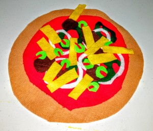 KIds can create their own pizza for pretend. No calories; no salt and non-digestible felt pizza.