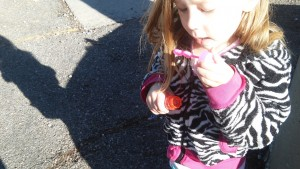 Pre-K kids love generic bottles of bubbles and big shadow ona sidewalk.