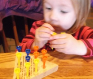 Small children enjoy Peg Board games. They don't have to play by any rules yet.