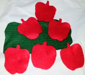 6 red felt apples are great for finger plays and counting.