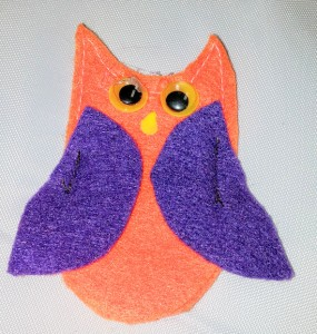 Felt owl with google eyes is a finger puppet who-o-o has a secret pocket in the felt tree.