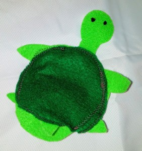 This 2 toned green turtle finger puppet can hide it's head inside its felt shell.