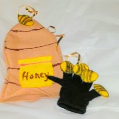 Bee HIve hand puppet with 5 bee glued on a back knit glove.
