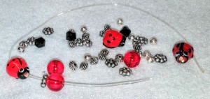 DIY Lady Bug Braceltte kits to compliment hand madefelt lady bug wings for dramtic play.