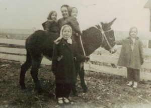 That is me, young No Non-cents Nanna holding the Francis our burro's nose.