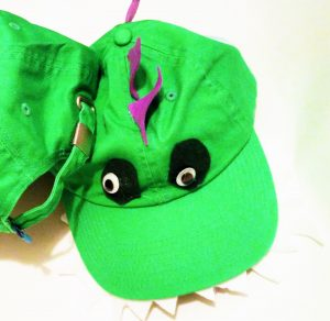 Heart Felt Play Store Dinosaur Critter Cap at only $3.99 each plus shipping and tax has adjustable strap in back for one-size-fits-all.