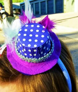 Girls eyes will light up when they see these tiny purple nut cup hats ona head band Each hat is unquely hand crafted.