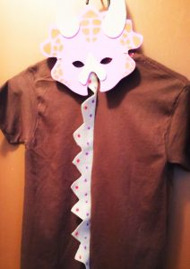 Dinosaur mask and back of Dino T-shirt set this one has color coordinated dino -spine made of felt as do most of No Non-centsnanna's hand crafted dino-T-shirts