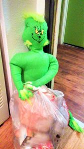 OMG! Short green guy is stealing my trash! He is a Grinch!